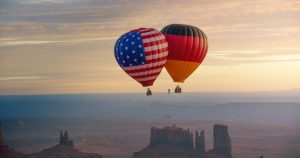 American and German flag on balloons with slackliner