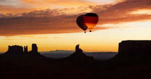 Balloon highline above monument valley at sunrise