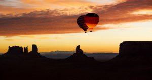 Balloon highline above monument valley at sunrise