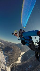 Jumping out of a paraglider in winter
